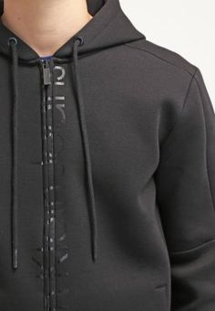 https://www.zalando.pl/calvin-klein-jeans-jepson-bluza-rozpinana-black-c1822s00k-q11.html