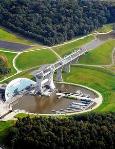 The Falkirk Wheel is a rotating boat lift in Scotland. It connects the Forth and Clyde Canal with the Union Canal. - http://www.theworldgeography.com/2013/04/unusual-elevators.html