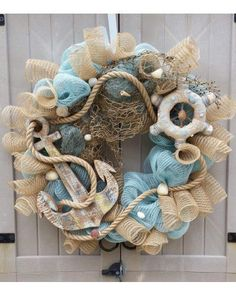 Light Blue and Natural Jute Mesh, Fish Netting, Shells, Ships Wheel and Large wooden Anchor adorn this wreath on 18 Coastal Wreath, Nautical Wreath, Anchor Wreath, Nautical Craft, Vintage Nautical, Nautical Theme, Summer Deco, Seashell Crafts, Beach Crafts