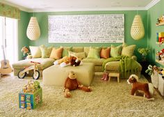 beautiful basement playroom, love the couch, color scheme and  the use of the plush toys as part of the decor, just love it