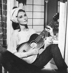 Playing guitar on the windowsill Audrey Hepburn... Breakfast at Tiffany's