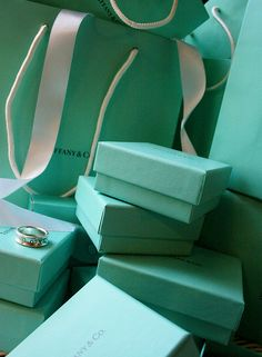Tiffany Boxes. My favorite color. Color of everything in my dreams for my room.