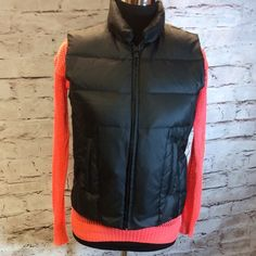 BANANA REPUBLIC BLACK DOWN PUFFER VEST This black puffer vest is in like new condition with full zip front and front zip pockets.. See pic for fabric content. I'm a true small and it fits me perfectly Banana Republic Jackets & Coats Vests