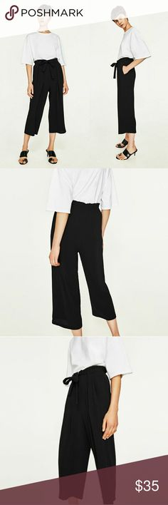 Zara High Waisted Wide Leg Culottes Black high waist culottes with pleats, side pockets and a belt that ties with a bow! Made of polyester for easy cleaning. Worn once! Very on trend for the fall - Sold out at most stores! Zara Pants