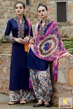 Get the profound and stylish look with this cobalt blue white punjabi patiala salwar suit. It is fine with embroidery design on neck and beautiful printed dupatta.