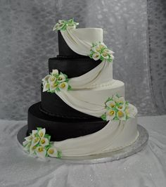 Black and white(turn to white and blue) wedding cake idea. Maybe we could add a little blue in there somewhere with the flowers to make it match the color scheme perfectly. Emerald Bridesmaid Dresses, Red Wedding Dresses, Wedding Colors, Elegant Wedding Cakes, Cake Wedding, Tuxedo Cake, Black And White Wedding Cake, Quinceanera Cakes, Green Cake