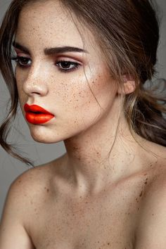 Stunning orange lip and natural face.