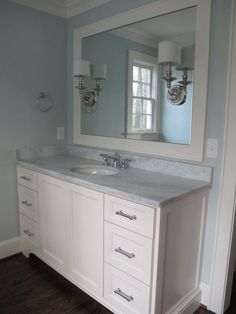 Suzie: Sherry Hart Designs - Gorgeous bathroom with blue walls, extra-wide single creamy white ...