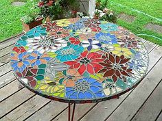 I can imagine having dinner parties and socializing around this beautiful mosaic table :)