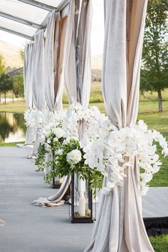 Ceremony Drapery with Orchid Décor | Photography: Perez Photography. Read More: http://www.insideweddings.com/weddings/incredible-tented-ceremony-barn-reception-at-ranch-in-aspen/860/