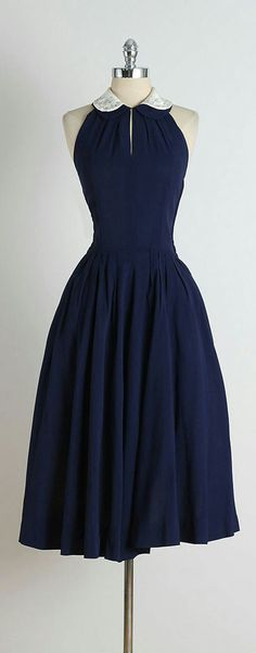50s style swing dress beautiful color. Would wear paired with a cardigan