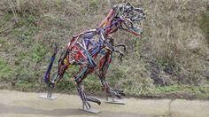 Bicyclaurus Rex Sculpture by Ptolemy Elrington / Hubcap Sculptures.