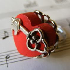 Valentine Ring Tutorial: Today I am going to share how I made it. Here is what you need:  Wood Heart Bead Key Charm Ring Blank (I used a Filigree design) Jewelers Glue Jewelry Wire  Directions:  First using the wire attach the key to the heart.  Then using your glue attach the heart to the ring.  That's it.