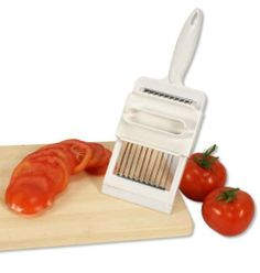 Luciano Tomato Slicer with Safety Holder by CTG. $11.07. 4 inch wide x 11 inch in length. Includes Safety Holder. Stainless steel serrated blades. Tomato slicer with stainless steel serrated blades. Slice the whole tomato evenly, quickly, and easily with this tomato slicer