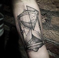 Blackwork hourglass tattoo by Lucas Martinelli