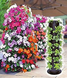 DIY Flower Towers – If you're looking for some fun new ways to brighten up your yard, these DIY flower tower ideas are sure to tickle your fancy. Long Flower Pots, Flower Planters, Garden Planters, Beautiful Gardens, Beautiful Flowers, Yard Water Fountains, Contemporary Planters, Flower Tower, Flower Pot Design