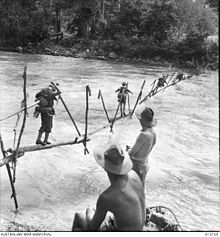 On the road to Buna, Australian troops cross the Kumusi River on an improvised bridge. Anzac Day, Lest We Forget, Aussies, Vietnam War, Papua New Guinea, Military History, Western Australia, Armed Forces, World War Two