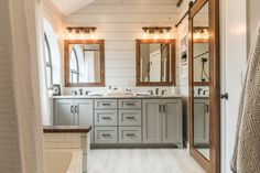Modern Farmhouse Bathroom - The Top 10 New Bathrooms on Houzz.com #masterbathroom #bathroomremodel #bathroomrenovation #bathroombeforeandafter #farmhousebathroom #modernfarmhouse #farmhousedesign #shiplap #whiteshiplap #grayshiplap #bathroomshiplap #customcabinets #graycabinets #granitecounters #whitegranite #colonialwhitegranite #oilrubbedbronze #industriallightfixtures #woodgraintile #whitewashedwood #woodtileflooring #cedar #cedarmirrors #cedardoor #barndoor