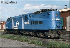 """Legendary Pennsylvania Railroad GG1 """"Old Rivets,"""" #4800, the first such model the company ever owned (essentially a prototype with riveted, instead of welded seams) actually made it into Conrail paint. The unit is seen here in Wilmington, Delaware during September of 1979. Today, she is preserved at the Railroad Museum Of Pennsylvania in Strasburg."""