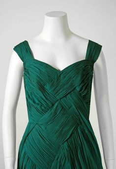 1954 Jean Desses Haute-Couture Seafoam Green Pleated Silk-Chiffon Evening Gown. This exquisite gown dates back to when Jean Desses housed his atelier at the famous 17, Avenue Matignon address. Fashioned from exquisite seafoam green crepe silk-chiffon, this show-stopper has everything a woman wants. The bodice is a seductive sweetheart plunge with complex pleatwork flowing down the garment in an almost criss-cross construction. Detail