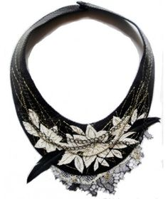 Black shiny leather with white flower fish leather elements. Antique gold metallic and white silky embroidery. Antique metal chains and black feathers. Black and antique gold lace elements. Closure with snap metal button. Size: h. cm.26 X l. cm.17,5 - See more at: http://www.ibavenue.com/products/woman