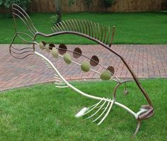 Steel rod, tube and plate #sculpture by #sculptor Ashley Baldwin-Smith titled: 'Mirror Carp'. #AshleyBaldwinSmith