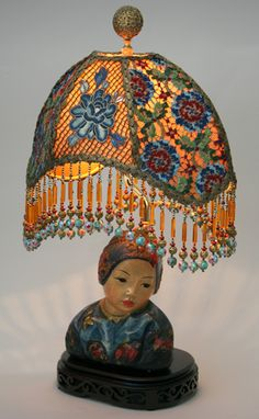 Wonderful antique chalk ware statue base by artist Esther Hunt is adorned with a colorful Chinese Rose lampshade with antique Chinese embroidery and exotic, antique multi-colored lace.