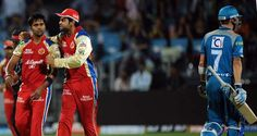 Royal Challengers Bangalore cricketer Vinay Kumar (L) is congratulated by capatain Virat Kohli (2nd L) after taking the wicket of Pune Warriors India batsman Michael Clarke during the IPL Twenty20 cricket match between Pune Warriors India and Royal Challengers Bangalore at The Subroto Roy Sahara Stadium in Pune on May 11, 2012.
