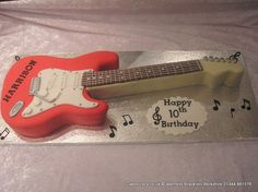 Fender Stratocaster Cake. Fender Stratocaster shaped cake covered in red and cream sugarpaste
