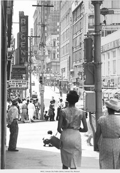12th Street - Photograph of 12th Street, looking west from Grand Avenue. Regent Theater in view.    Date ca. 1961