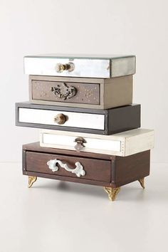 Topsy-Turvy Jewelry Box. What appears to be a precarious stack of mismatched drawers is in fact a sturdy safe-haven for your trinkets and charms, detailed with vintage hardware.