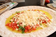 Feta Dip - w/raw tomato, scallions, olive oil and greek seasoning. Serve with thin sliced baguette