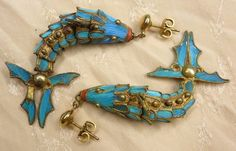 Antique articulated Chinese blue kingfisher earrings...how awesome! (BlueGrotto on etsy)