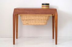 Danish midcentury sewing table with bevelled corners. Side drawer reveals beech-lined partitioned storage