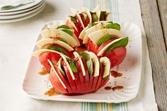 Don't settle for a regular stacked caprese salad! Treat your tomatoes like potatoes and don't slice them all the way through — then, stuff with slices of provolone and torn basil. Drizzle with balsamic and garnish with fresh cracked black pepper.