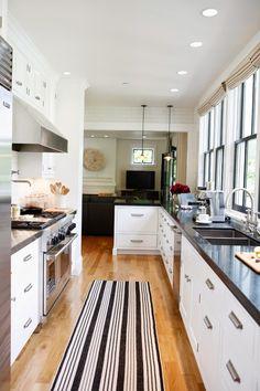 Because It's Awesome: Modern Farmhouse // black-stripe rug, white cabinets, farmhouse pulls, gooseneck faucet