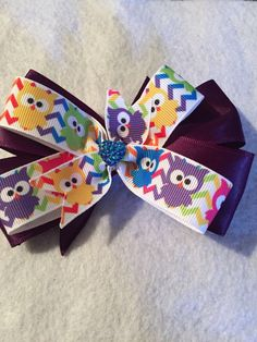 A personal favorite from my Etsy shop https://www.etsy.com/listing/519280871/owls-and-more-owls-hair-bow