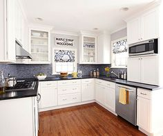 All-white cabinets are complemented with this kitchen's dark countertops and backsplash: http://www.bhg.com/kitchen/small/small-white-kitchens/?socsrc=bhgpin012214ceilinghighstorage&page=8