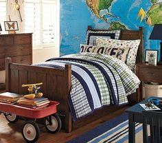 """I am in LOVE with this look for my Patrick.  The mural is great and it takes all my favorite colors: white, light blue, navy blue, green checks.  The """"Discover"""" pillow is just fantastic!"""