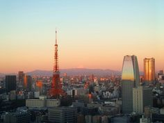 """6am Tokyo - Sunrise hits the Tokyo Tower and other buildings giving it a orange and reddish hue with Mount Fuji in the back. Waking up to this scene is kind of surreal but it can be done.  Staying at the Royal Park Hotel Shiodome rooms have an amazing view of these """"Charms of Tokyo"""". The hotel starts from the 25th floor upwards therefore you will be getting awesome views of Tokyo City when you book your stay here. . . . """"Place Taken"""" - Royal Park Hotel Shiodome Tokyo. . . . #my_and_tokyo2017…"""