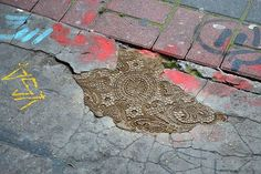 Polish artist @nes.poon uses ornate lace patterns to decorate decayed streets and gives them a new charm