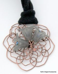 Kath's Elegant Accessories, LLC created this Ecochic Grey Lucite Lily Flower Pendant for celebrities at the 2012 Golden Globes Event through The Artisan Group  - Lily