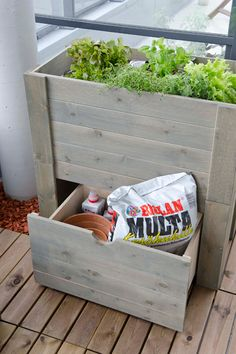 A fab idea for raising up the plants to the light (ideal if you have a low wall), with storage underneath!