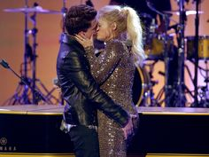 Singers Charlie Puth, left, and Meghan Trainor kiss onstage at the American Music Awards.  Kevin Winter, Getty Images