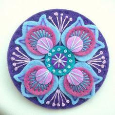 DSCN0861   Marrakesh felt brooch in violet   By: APPLIQUE-designedbyjane   Flickr - Photo Sharing!