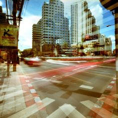 Holga cross-process shot of an intersection, Bangkok, Thailand, photograph by Rob Allen. Bangkok Hotel, Bangkok Travel, Bangkok Thailand, Places Around The World, Around The Worlds, Medium Format Photography, Exotic Places, Concrete Jungle, Discount Travel