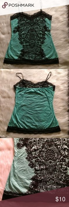 Almost famous lace tank top Beautiful teal and lace tank top the brand is almost famous and it's a size large. (The wrinkling is because of the material) Almost Famous Tops Tank Tops