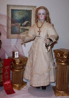 """In my personal collection is this approximately 19"""" Bru smiler, also known as the empress Eugenie doll, on her original all jointed wooden body in her atelier original clothing, including little leather boots with elastic inserts. Her wig and even her necklace is all original and quite pristine.She dates to the late 1860's. come visit UNDER The LILACS on Ruby Lane, and Under The Lilacs on facebook!"""