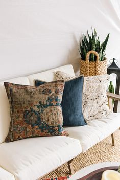 This printed pillow cover highlights the beauty of an antique rug, with muted colors and worn markings that tell the story of decades of treading feet. Living Room Cushions, Cushions On Sofa, Rugs In Living Room, Home And Living, Living Room Decor, Cream Living Rooms, Living Room Styles, Coffee Table Design, Room Inspiration