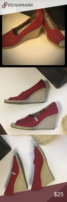 Toms🔥 Red Hot 🔥Wedges! Excellent preloved condition! Toms Classic Stella style Peep toe wedge with red canvas. Hardly worn. Soles still have great traction! Great shoes, great cause, great bargain!! TOMS Shoes Wedges